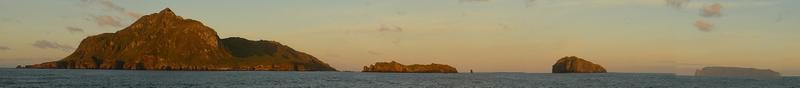 Nightingale Island, Middle Island, Stoltenhoff Island &  Trsitan da Cunha at sunrise on April 13, 2015 (L-R)