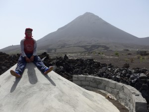 Zuka sitting on top of his house half buried in lava