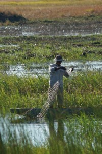 A guide fishing for his family