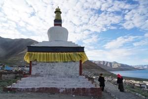 Bon followers walk around the stupas counter-clockwise